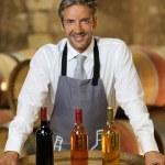 Wine waiter standing in wine cellar — Stock Photo