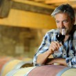 Winemaker tasting red wine in winery — Foto Stock