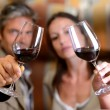 Winemakers holding glasses of red wine - Stock Photo