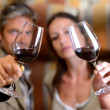 Stock Photo: Winemakers holding glasses of red wine