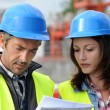 Closeup of engineers with blue helmet on building site — Stock Photo
