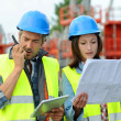Engineers on building site controlling project — Stock Photo