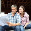 Couple sitting in house under construction — Stock Photo