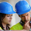 Stock Photo: Closeup of construction with blue security helmet
