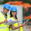 Construction using electronic tablet on site — Stock Photo #13930701