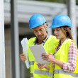 Construction using electronic tablet on site — Stock Photo