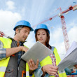Construction manager and engineer working on building site — Stock Photo #13930730