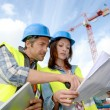 Stock Photo: Construction manager and engineer working on building site