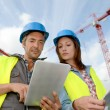 Construction manager and engineer working on building site — Stock Photo