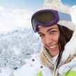 Portrait of woman at the mountain in ski outfit — Stock Photo