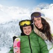 Mother and daughter skiing in the mountain - Stock Photo