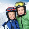 Royalty-Free Stock Photo: Portrait of children in ski outfit at the mountain