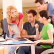 Woman in wheelchair attending group meeting — Stock Photo #13932171
