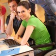 Woman in wheelchair attending group meeting — Stock Photo