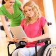 Handicapped person at work with electronic tablet — Stock Photo