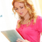 Portrait of girl at university using tablet — Stock Photo