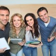 Portrait of cheerful students at college — Stock Photo