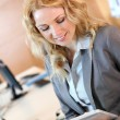 Portrait of smiling young businesswoman in office — Stock Photo