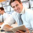 Portrait of business manager using electronic tablet — Stock Photo