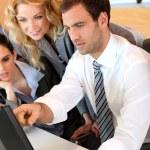 Business meeting in front of desktop computer — Stock Photo