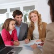 Stock Photo: Family signing real-estate contract