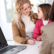 Woman in real-estate agency with kid — Stock Photo #13932580