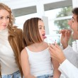 Doctor looking at sick little girl throat — Stock Photo