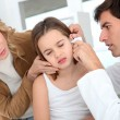 Doctor looking at little girl ear infection — Stockfoto #13932605