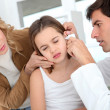 Doctor looking at little girl ear infection - Stok fotoğraf