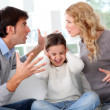 Couple fighting in front of child - Foto Stock