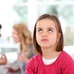 Portrait of upset child with parent's fighting — Stock Photo