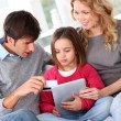 Royalty-Free Stock Photo: Family doing online shopping with tablet