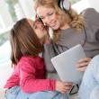 Mother and daughter listening to music — Stock Photo #13932655