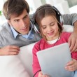 Father and daughter listening to music — Stock Photo