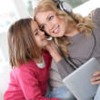 Mother and daughter listening to music — Stock Photo