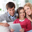 Family listening to music with tablet — Stock Photo