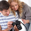 Couple looking at picture on camera screen — Stock Photo