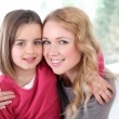 Portrait of happy mother and daughter — Stock Photo #13932700