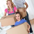 Family moving in new house — Stock Photo #13932703