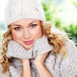 Royalty-Free Stock Photo: Portrait of blond woman wearing wool sweater and hat