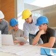 Stock Photo: Educator with students in architecture working on electronic tablet