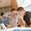 Educator with students in architecture working on electronic tablet - Stock Photo