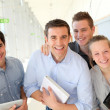 Portrait of students with teacher in school building — Stock Photo #13933144