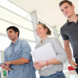 Stock Photo: Group of students walking in school hallway