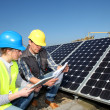 Man showing solar panels technology to student girl — Stock Photo #13933185