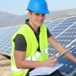 Young adult doing professional training on solar panels plant — Stock Photo #13933190