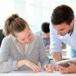 Teacher with student girl writing assignment — Stock Photo #13933227