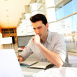 Young man studying at university - Stock Photo