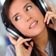 Stock Photo: Beautiful young woman listening to music