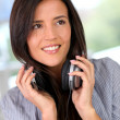 Beautiful young woman with music headphones — Stock Photo